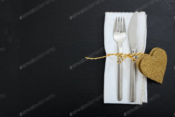 Valentines day place setting on black background