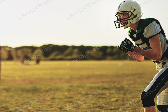 Football receiver waiting for a throw during team practice