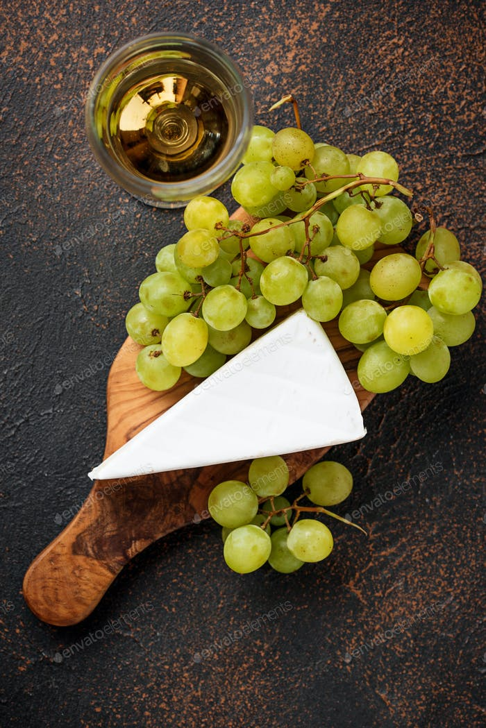 Cheese brie, grape and wine