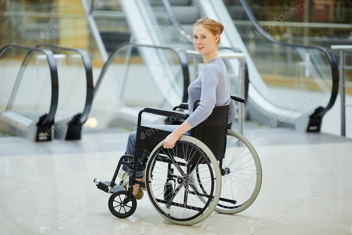 Disabled woman in wheelchair in the shop