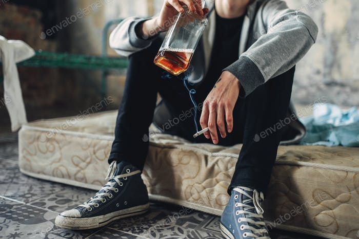 Addicted male person with cigarette and alcohol