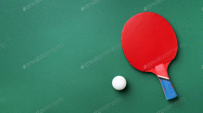Sport, fitness, healthy lifestyle concept. Ping-pong or table tennis rackets and white ball on green