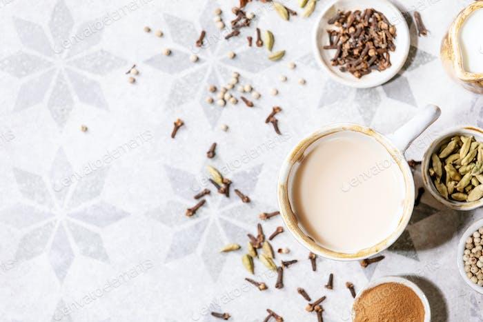 Masala chai served with cinnamon sticks
