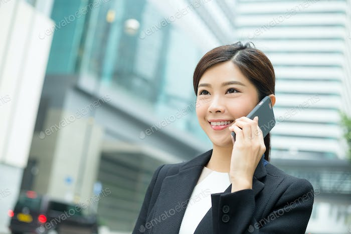 Business woman talking to cellphone