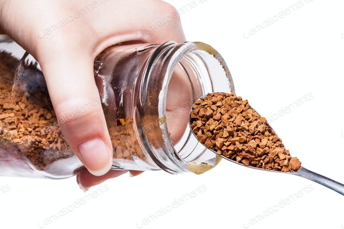 glass jar with coffee crystals and spoon isolated