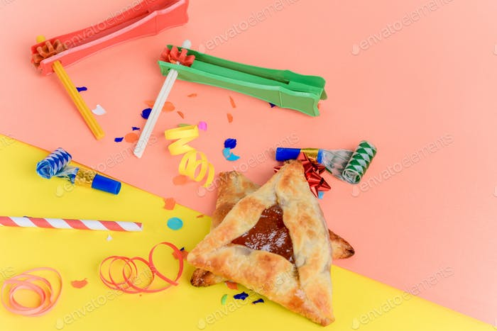 Purim background with party costume and hamantaschen cookies