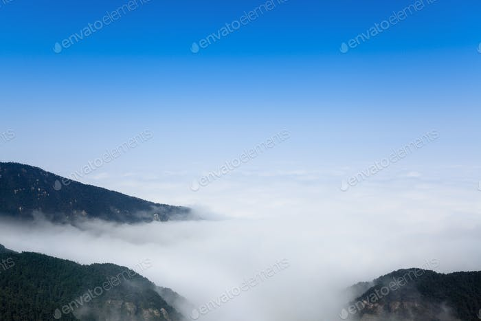 clouds and mist floating among mountain peak