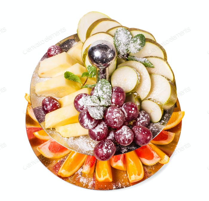 Delicious sliced fruits as a dessert platter.