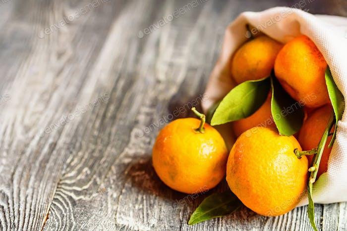 Mandarine orange or tangerine on wooden board