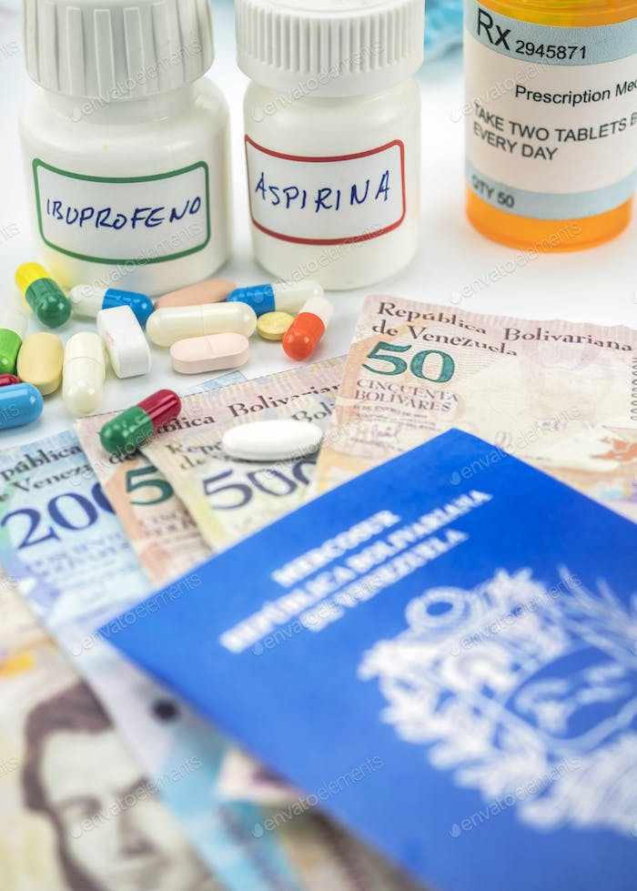Medicines next to banknotes of Venezuela, shady deal of medication