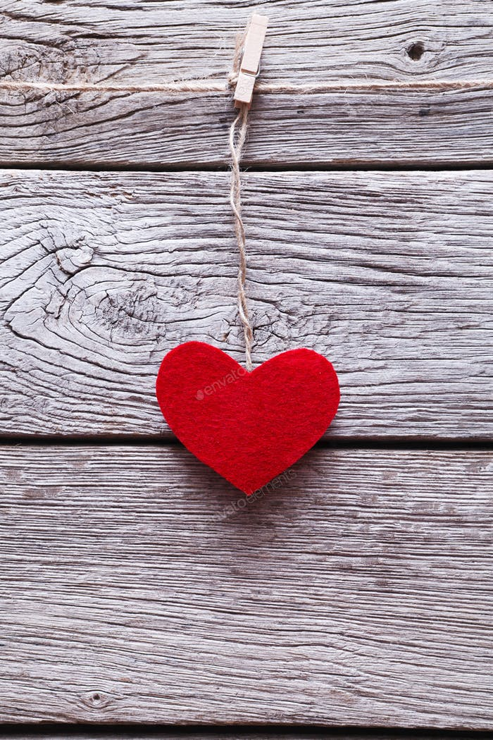 Valentine day background, paper heart on wood, copy space