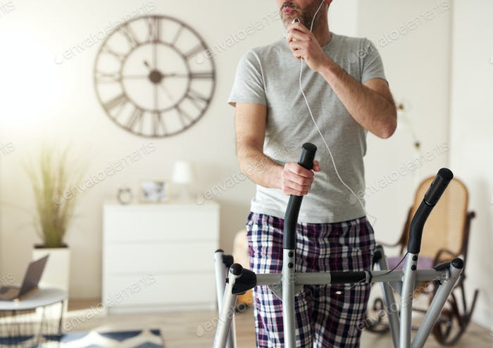 Man having a call while home workout
