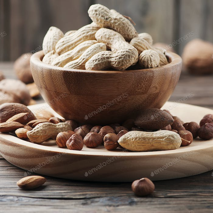 Mix of different nuts on the wooden table