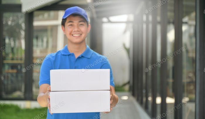 Parcel delivery worker holding a box in hand ready to deliver to customer, Delivery concept.