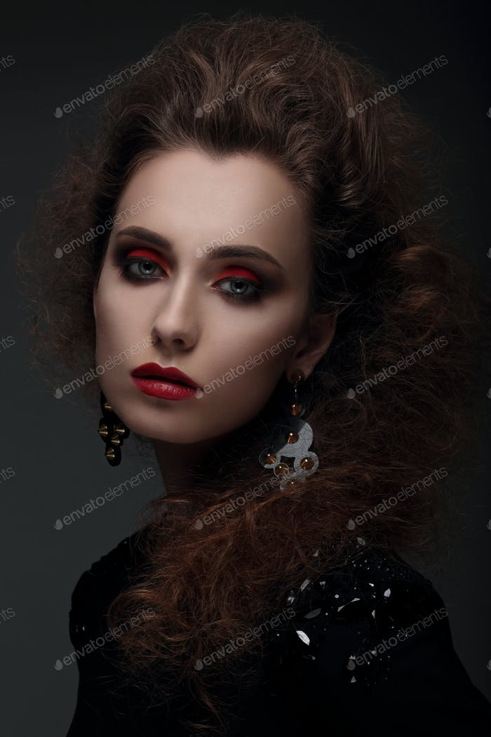 Portrait of a woman with high hair and red lips.
