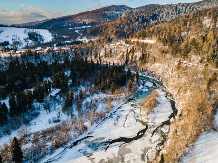 Ice Covered Frozen San River in Bieszczady Mountains Park in Poland at Winter Season