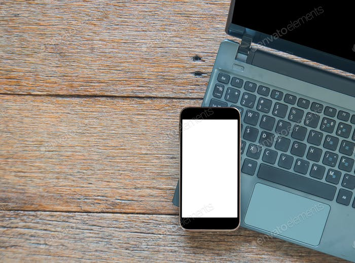 smart phone and Laptop computer  on wooden floor.