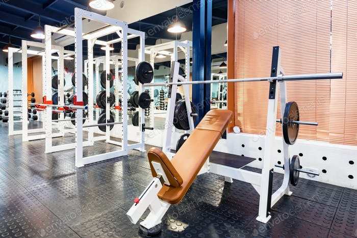 Empty bench press exercise machine in modern gym