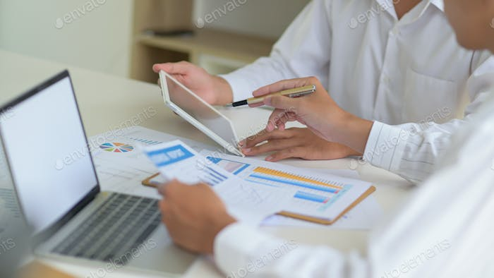 Executives with tablet are evaluating the situation of company to resolve impact of virus outbreak.
