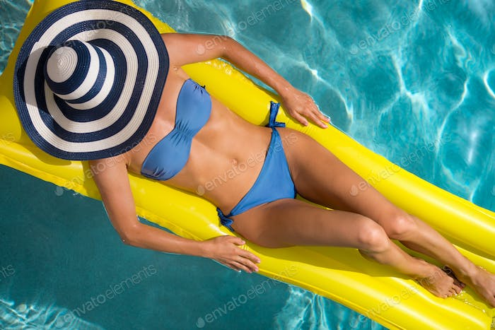 Top view portrait of woman in the swimming pool