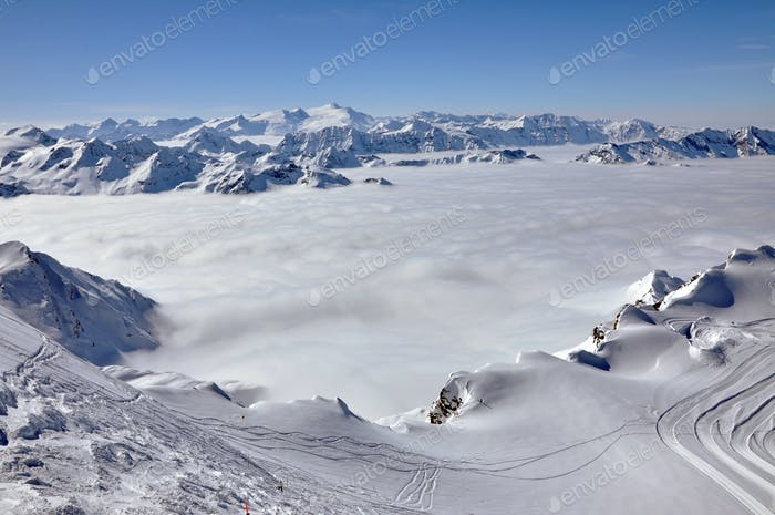 Snow covered mountains and fog
