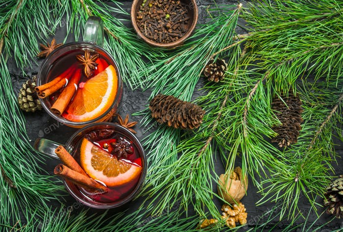 Mulled wine with fir branches and cones.