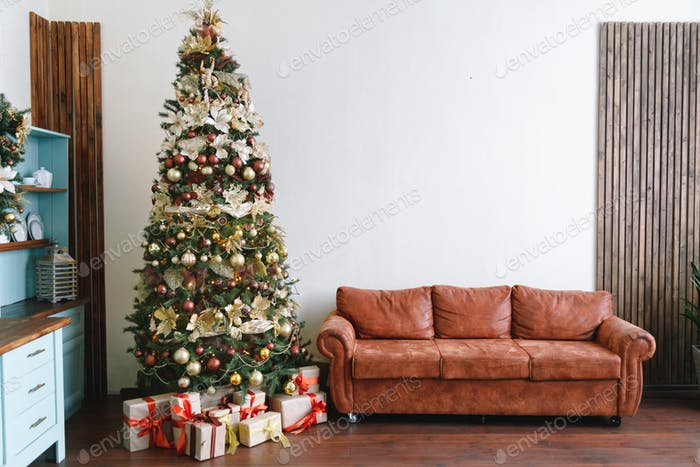 Christmas tree with leather sofa in a white room