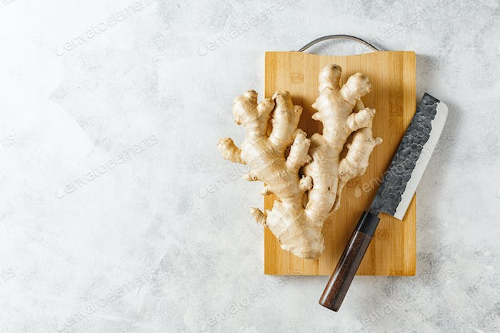 Fresh ginger root on a cutting board