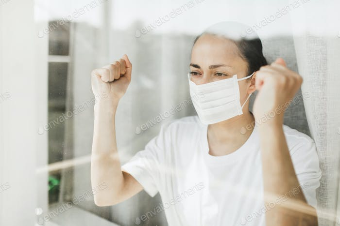Angry patient in hospital coronavirus quarantine self isolation want to go outside.