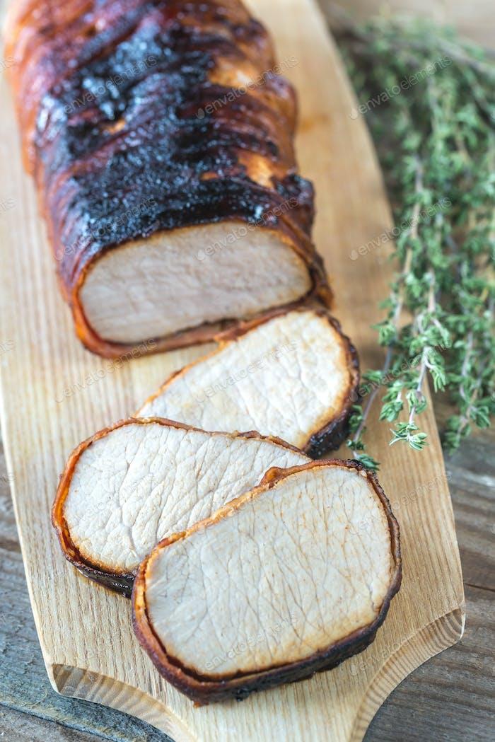 Pork loin wrapped in bacon