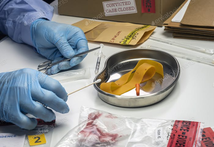 Specialized police analyzes syringe with traces of blood from a victim overdose