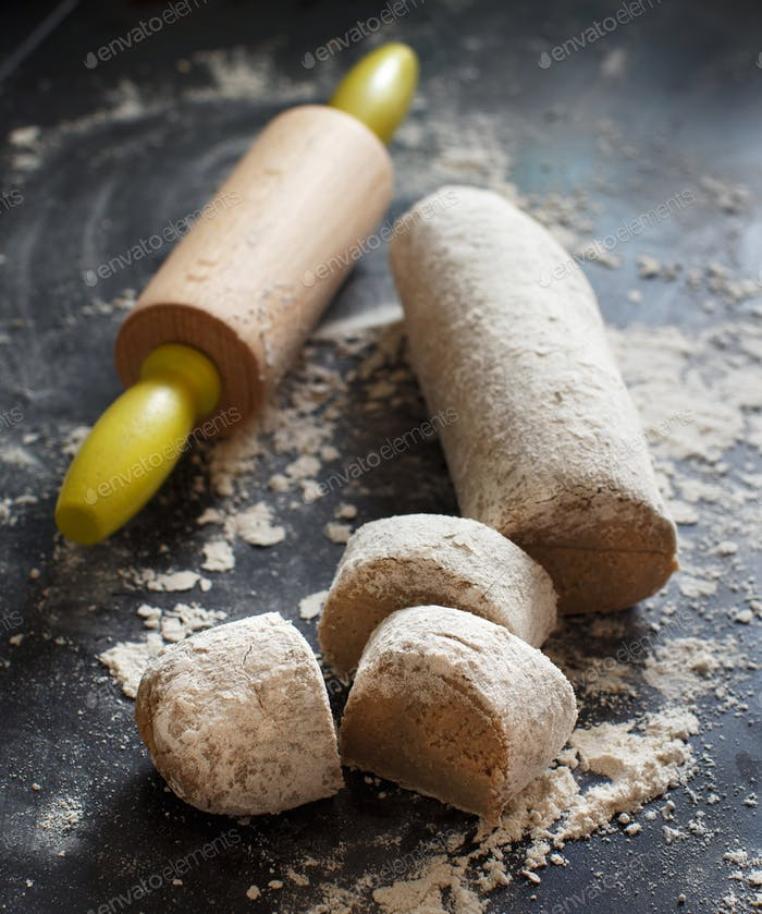 Pieces of raw dough with a knife
