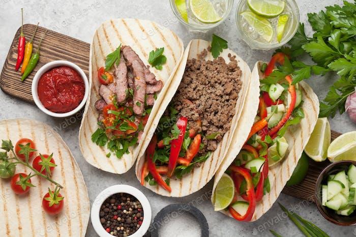 Mexican tacos and caipirinha cocktail
