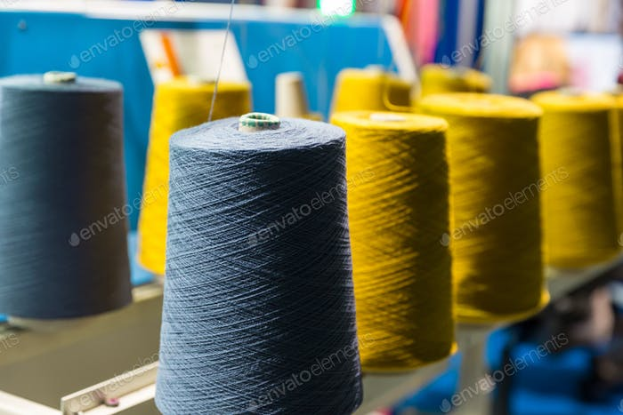 Spools of color threads closeup, sewing equipment