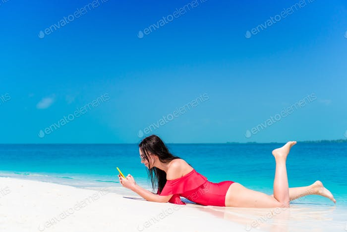 Beautiful woman during tropical beach vacation