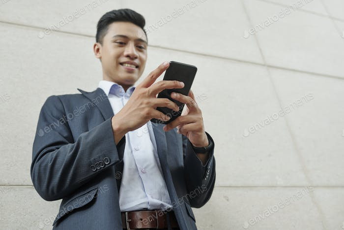 Businessman checking text messages