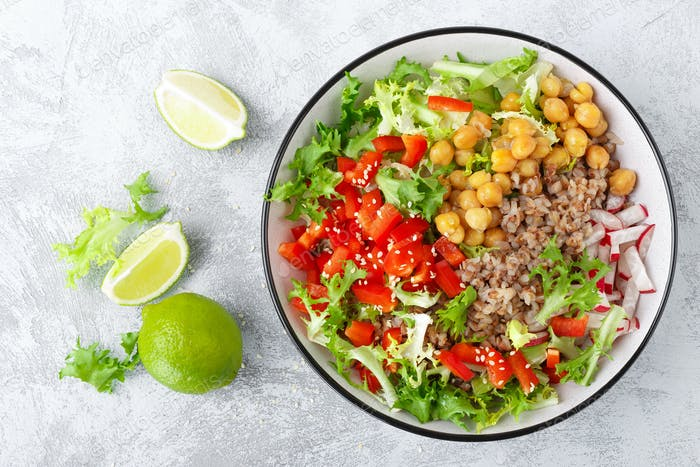 Bowl with buckwheat and salad of chickpea