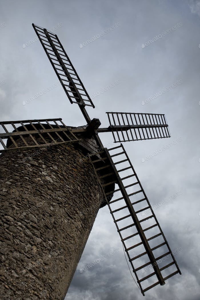 Mill and cloudy sky