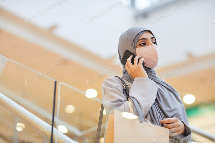Middle-Eastern Woman wearing Mask in Shopping Mall