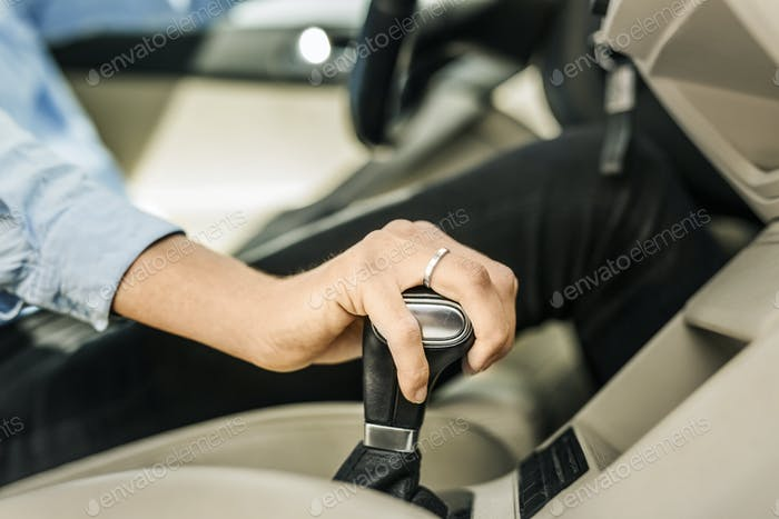 Mid section of woman driving car