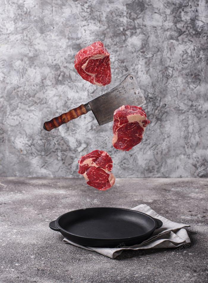 Raw marbled ribeye steak. Food levitation