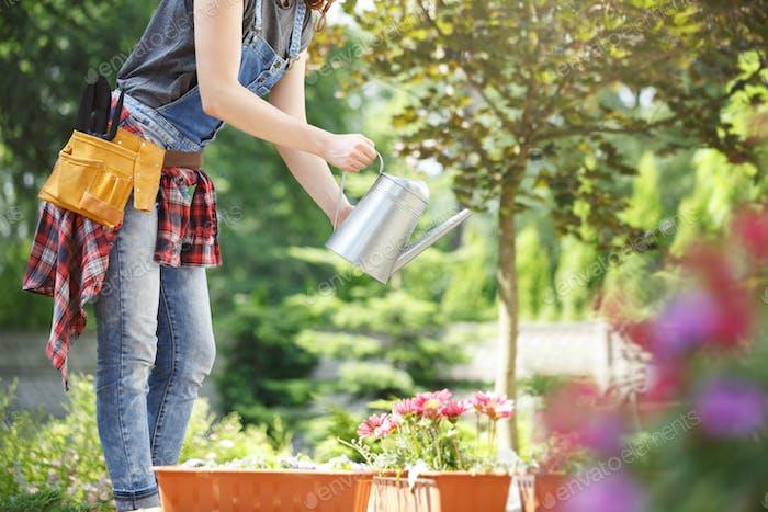 Gardener showing clients flowers
