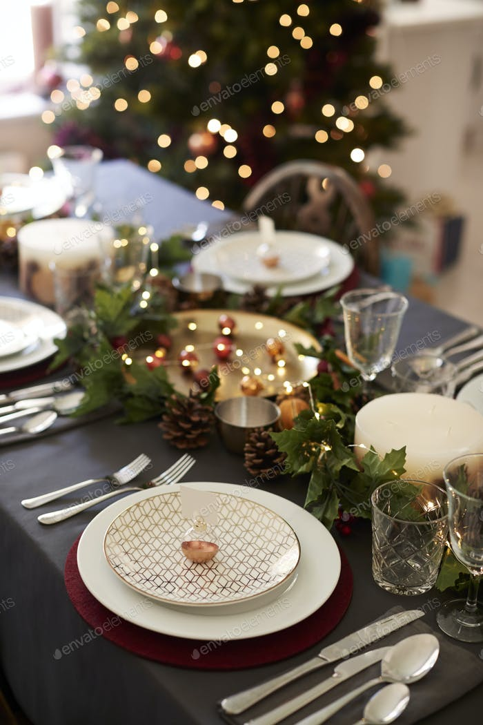 Christmas table setting with bauble name card holder arranged on a plate