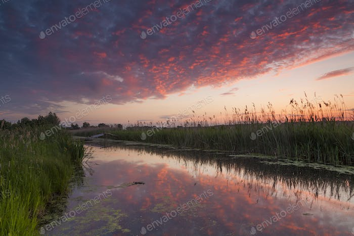 Beautiful red sunset over a small river