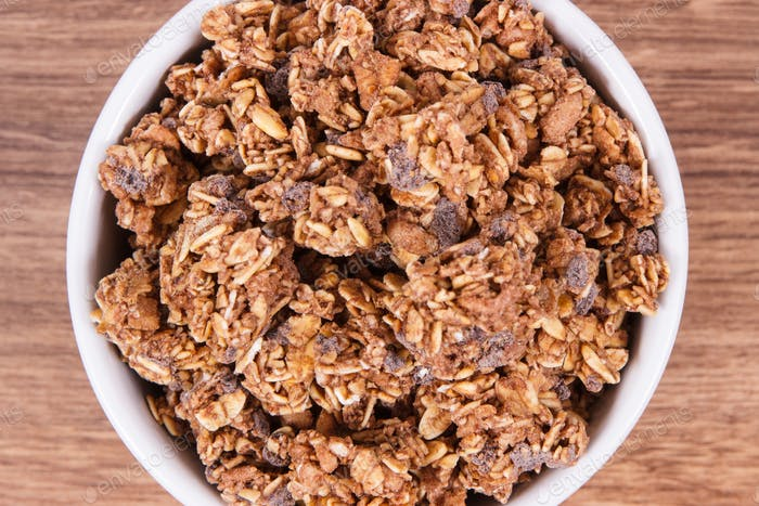 Oat flakes with chocolate as source iron and fiber, healthy snack concept