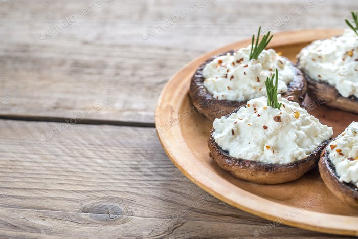 Baked mushrooms stuffed with cream cheese