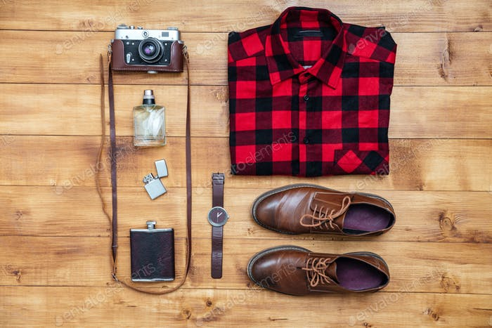 Travel concept shirt, camera, shoes, flask, lighter,watch, perfume