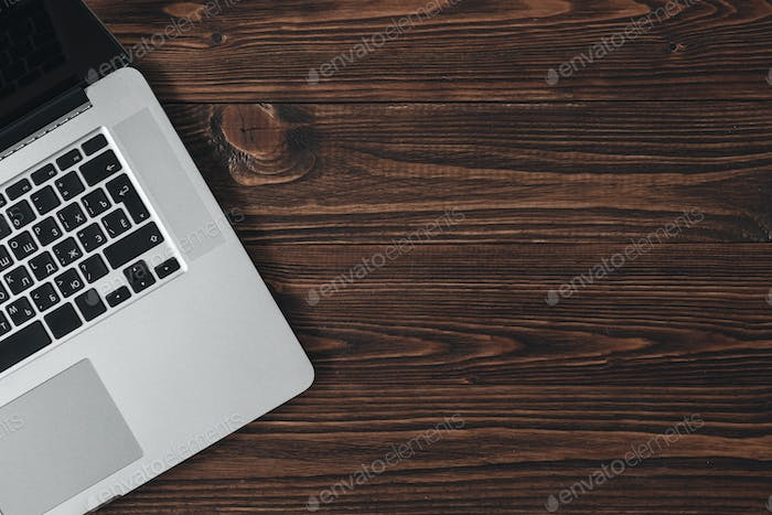 Laptop on the brown wooden desk