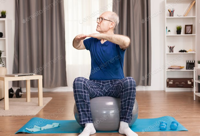Pensioner practicing sport at home