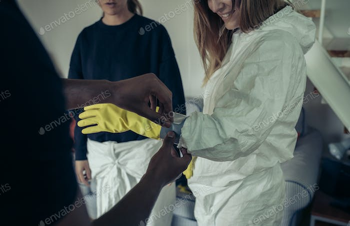 Man taping gloves to a woman